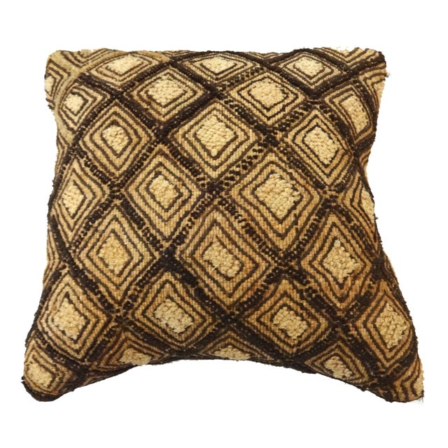 A small elegant African Kuba pillow with delicate embroidered geometric design made of raffia from a palm tree. The fabric...