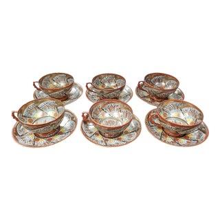 Circa 1890 Japanese Kutani Porcelain Thousand Faces Teacups and Saucers - Set of 12 For Sale