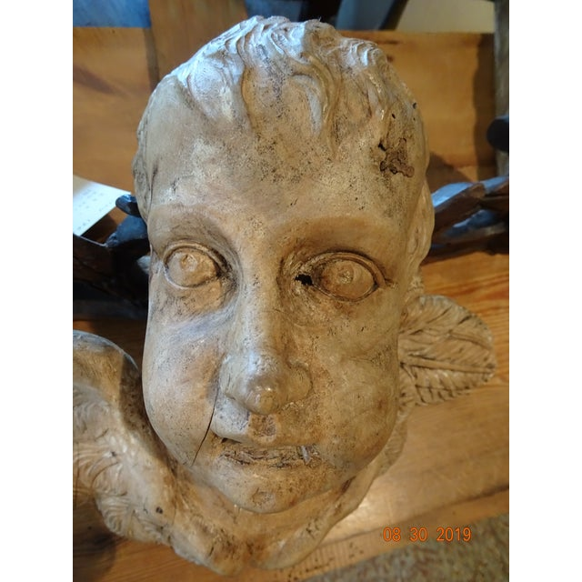 Exquisite little cherub from Portugal with his eyes wide open and his wings spread . Detailed raw wood carving. This...