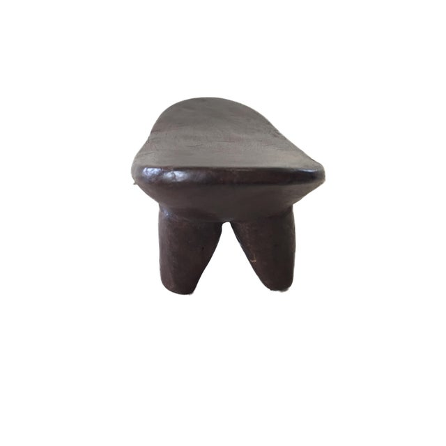 Superb African Senufo kids milk stool on four tapered legs with an abstract form . Carved from one piece of wood. Senufo...