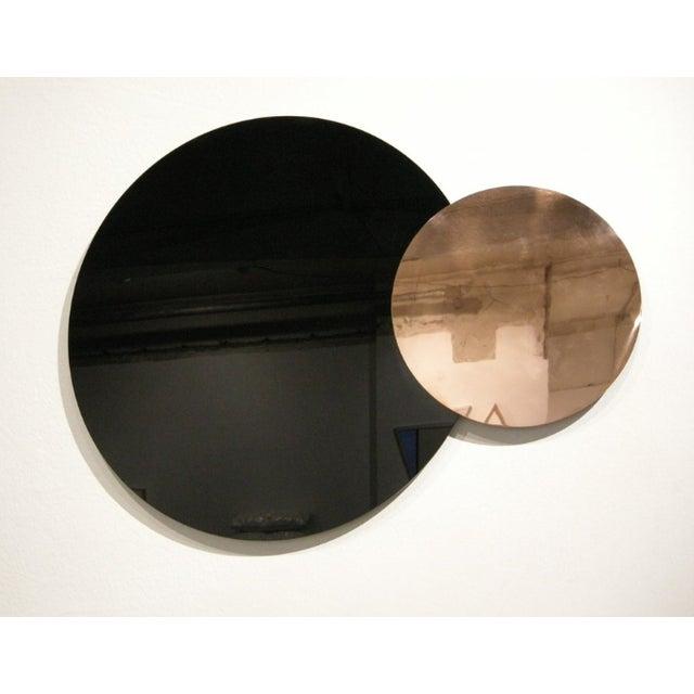 Circle Constructivist Mirror x Nina Cho YEAR: 2014 MADE IN: Detroit + Allen Park, MI ABOUT THE DESIGNER: Nina Cho is an...