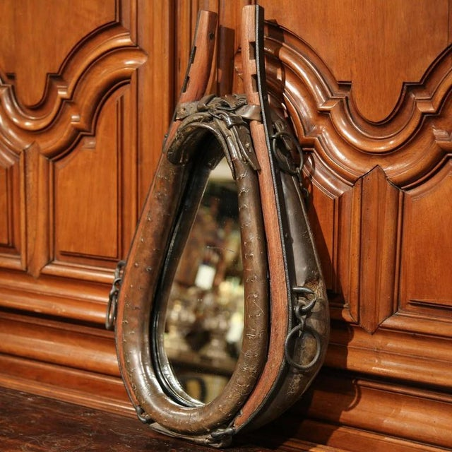 The mirror is a unique find for the rustic home. The mirror is framed by a fine, antique horse collar from France, circa...