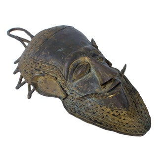 Early 20th Century African Baule Bronze Mask For Sale