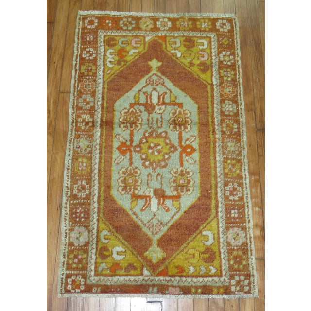 Hand-knotted One of a kind Vintage Turkish Anatolian rug with medallion and border design.