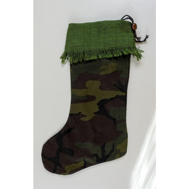 Custom Christmas stocking hand made from cotton camouflage and vintage green burlap. Twine hanger with vintage leather...
