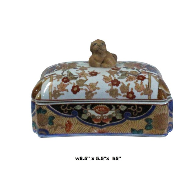 This is a colorful porcelain decorative box container in an oriental Chinese enamel style graphic finish which has a mix...