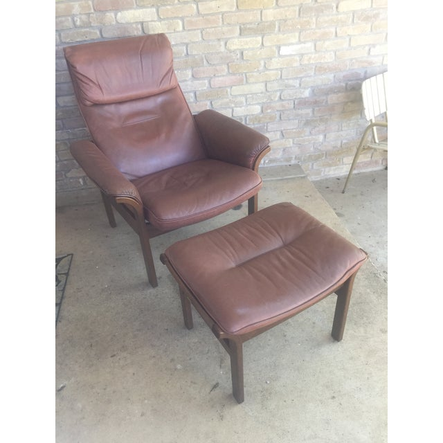 Super comfortable and stylish reclining lounge chair with matching ottoman. Beautiful curved wood frame with nice patina...