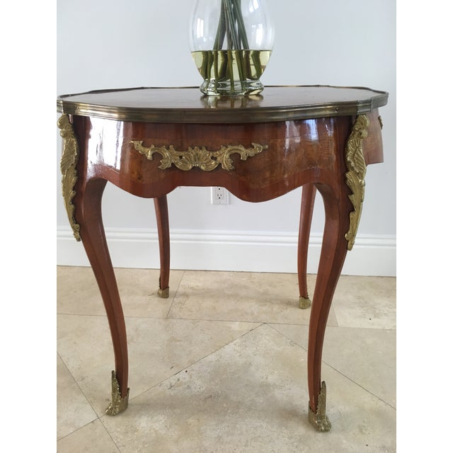Preserved vintage table with brass details. French circa dateline 1940s. Beautifully designed for a timeless look. The...