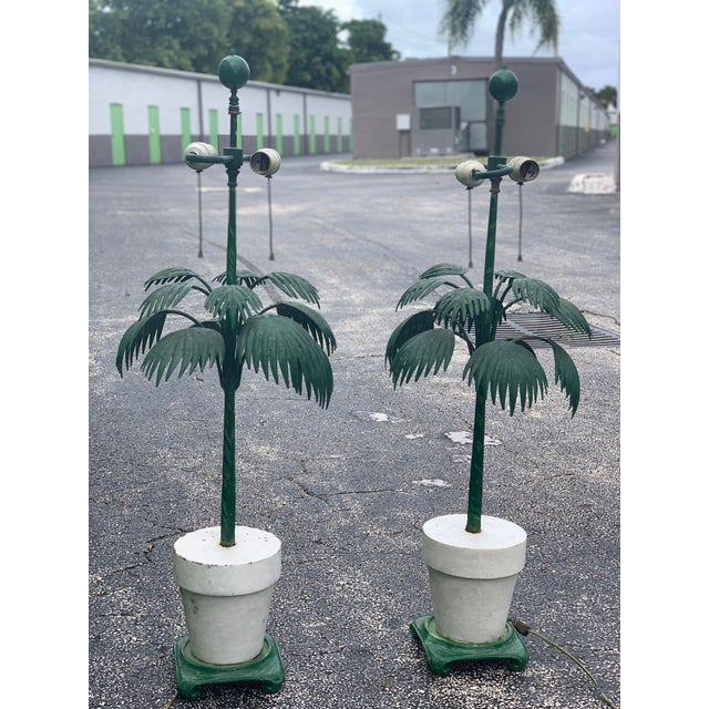 Vintage iron and ceramic palm frond table lamps. This pair of lamps are in amazing vintage condition, with the perfect...