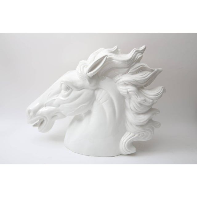 This large-scale figure of a horse head was produced in Italy and dates to the late 20th century. The white glaze gives...