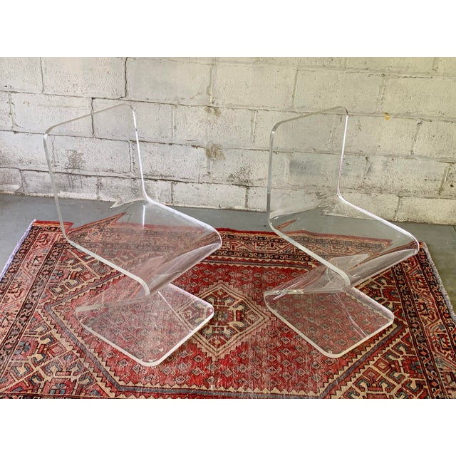Pair of Mid Century Modern Lucite Zig-zag chairs. Simple, modern design made from a single piece of heavy bent lucite for...
