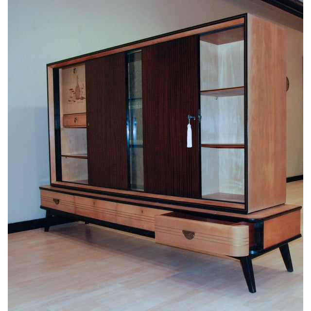 circa 1950 A fine German bar and display cabinet in various exotic woods with a marquetry still life design on the pull-...