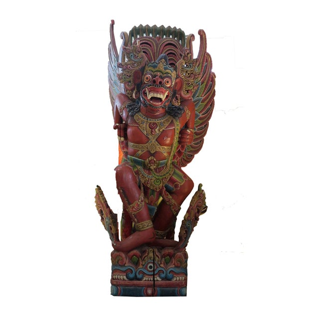 This is an amazing carved wooden Garuda statue. In India and Southeast Asia the eagle symbolism is represented by Garuda,...