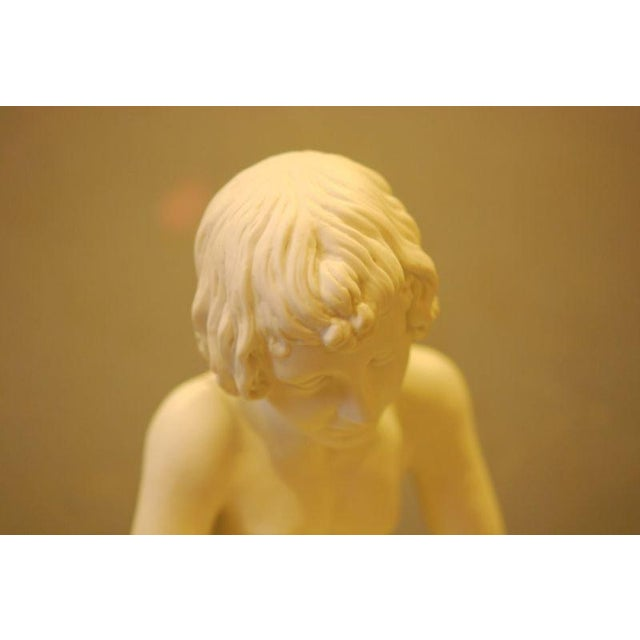 """13"""" high. Parian Replica of the original bronze statue in Italy titled, Boy with Thorn. Boy with Thorn, also called Fedele..."""