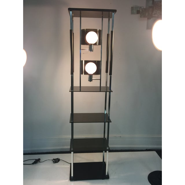 Great mod design floor lamp with two swiveling smoky Lucite shade lamp fixtures set within a cool chrome square tubing...