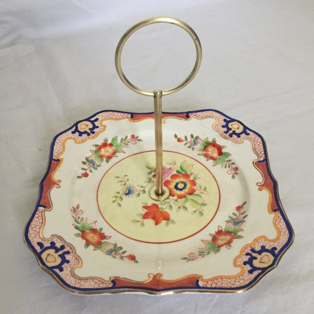Colorful mid-century modern square candy dish. Beautifully hand painted with bright floral motif and gilded along the...