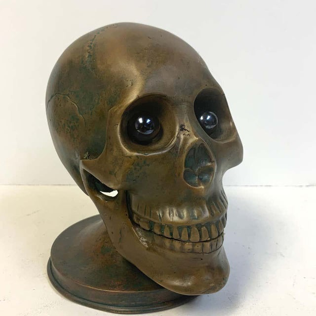Victorian bronze skull with glass eyes, by S.W. Farber, New York, realistically cast and modeled, with inset round glass...
