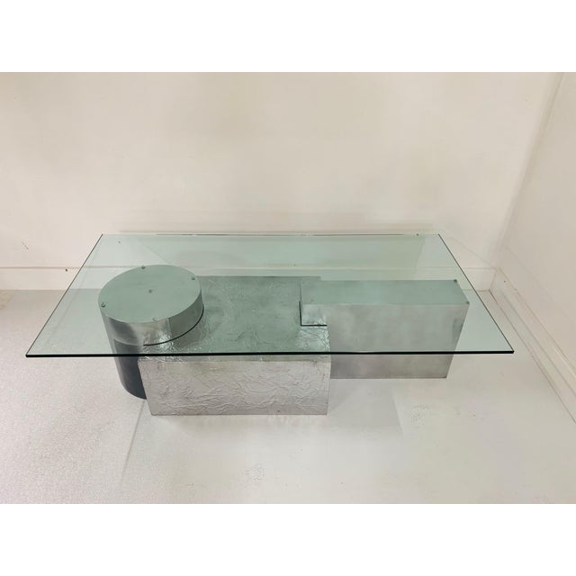 Three-piece geometrical coffee table. Unique base comprising of three sections which depicts 3-D puzzle pieces. Surfaces...