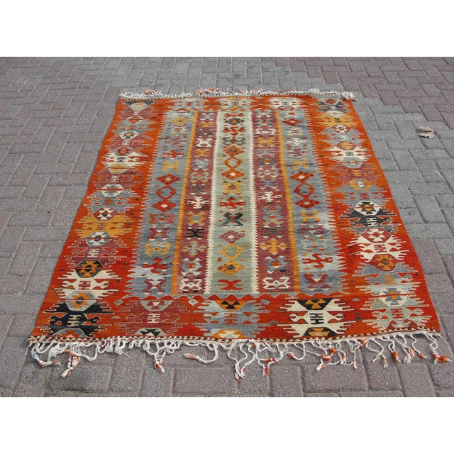 Vintage handwoven Turkish kilim rug. The kilim is nearly 55 years old. It is handmade of very fine quality natural wool in...