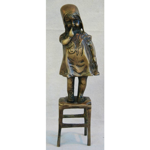 Offered is a vintage decorative Juan Clara-style bronze figure of a girl with one shoe standing on a chair. No maker's...