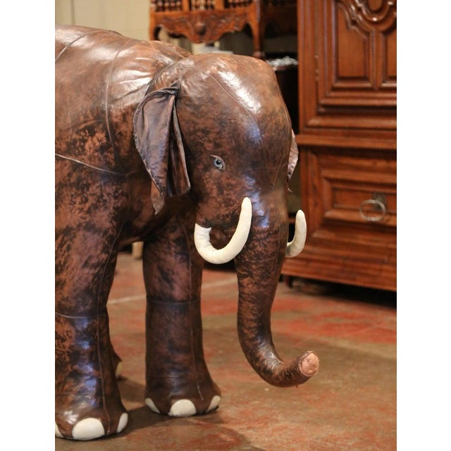 Decorate a child's room or game room with this large elephant calf sculpture. Created, circa 1970, and found in southern...