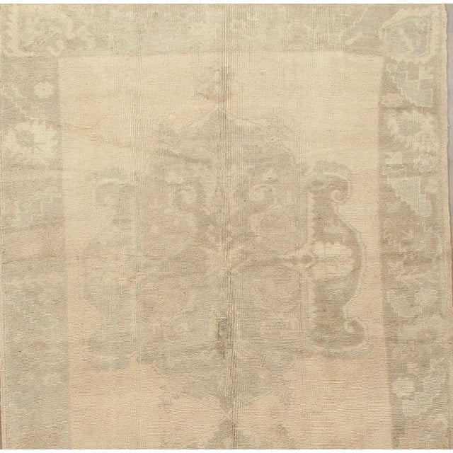 Turkish Oushak rug handwoven of high-quality wool in a warm color palette, circa 1940. Color: multi