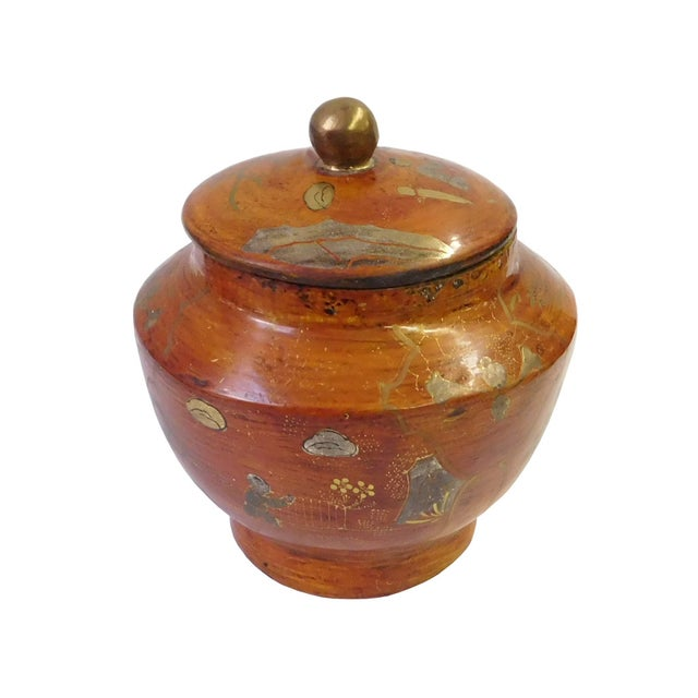 This decorative wooden container is painted with light brown lacquer on the surface and oriental scenery is precisely...