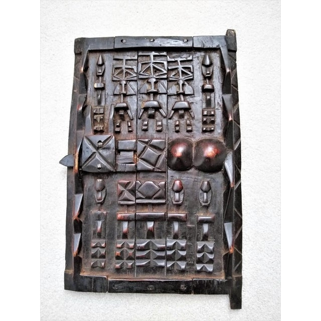 The Dogon tribe from Mali, West Africa uses these doors to protect the window-like opening into each family's grain...