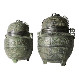 Chinese Bronze Pair of Archaic Lidded Urns For Sale