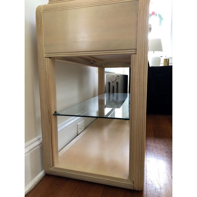 Features fine quality construction; center drawer, flip-out serving top with Formica center preparation area. Finished...