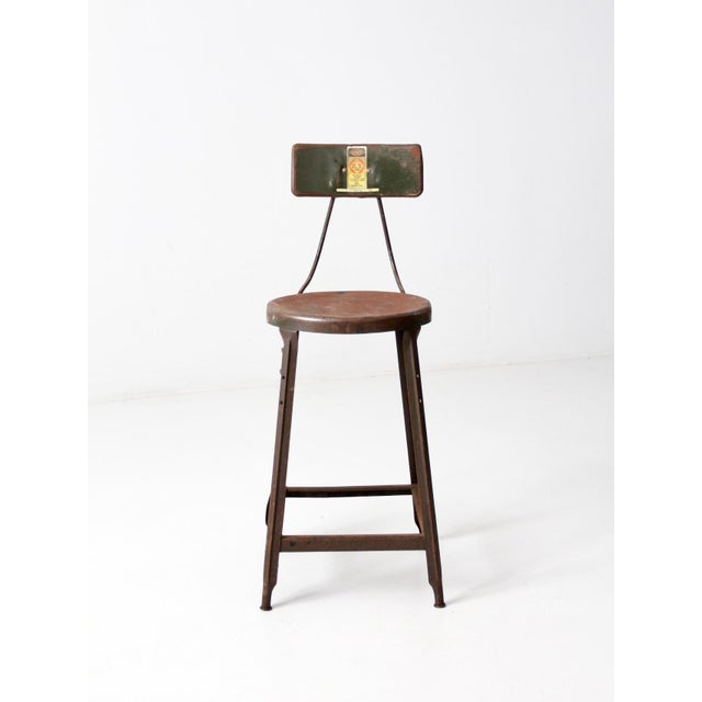 This is a vintage industrial Hallowell stool. The tall drafting stool has an attached back and olive green tone. Great...