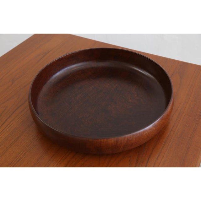 A beautiful wooden fruit bowl might be rosewood, not sure. The wood has great veining and knots. Has been cleaned up and...