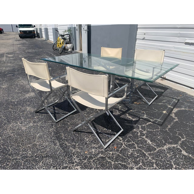 Time capsule! Dining set consisting of four chrome and leather/naugahyde director chairs and adjustable chrome table base...