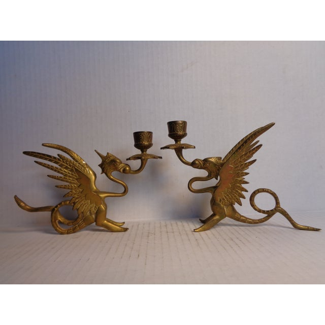 A beautiful pair of solid brass candlesticks in a dragon design.