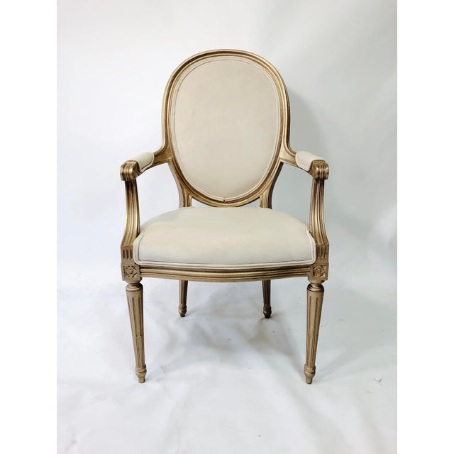 This is a pair of 19th century chairs that have been hand painted in a light golden finish. The have also been...