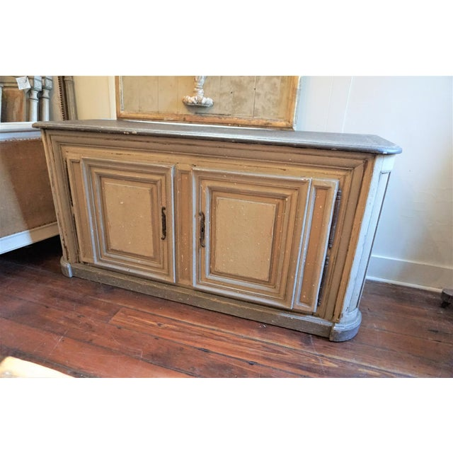 Early 19th century french 2 doors sideboard. The top is painted in a charcoal color. The buffet is painted in gray and...