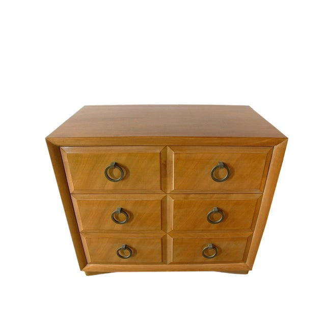 Handsome pair of three-drawer chests with heavy brass ring pulls. Lovely finish.