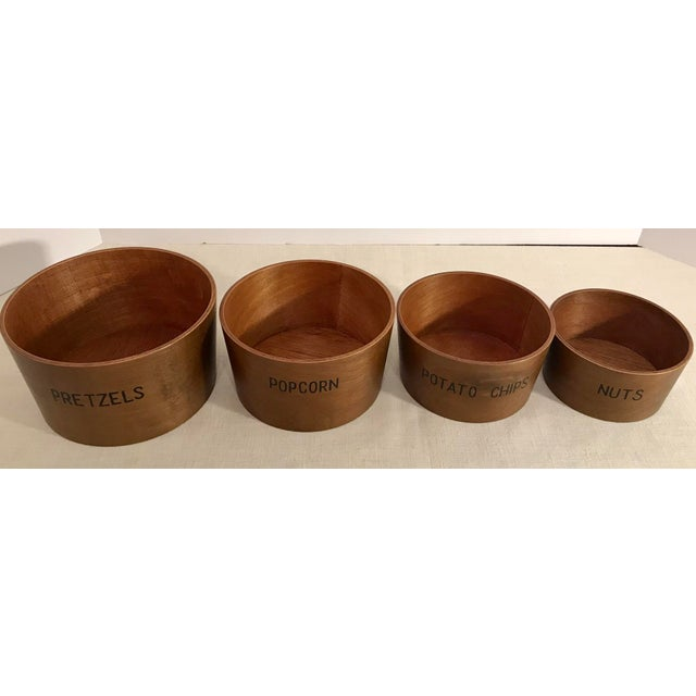 Mid Century set Of wood n nesting snack bowls. One each for popcorn, pretzels, nuts, and potatoes chips. Great for parties.