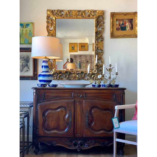 Beautiful Italian large gilt mirror with beveled edge. Stunning in entry way. Possibly from around 18th or 19th Century.