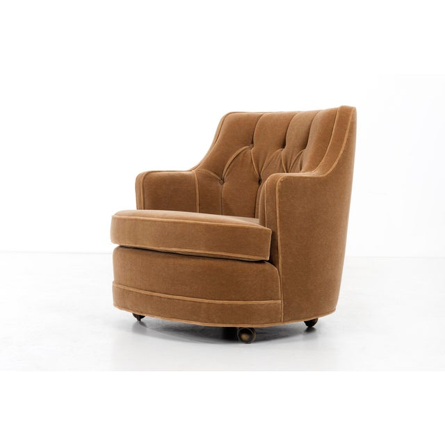 Newly upholstered tufted lounge chair with new foam in mohair, on casters.