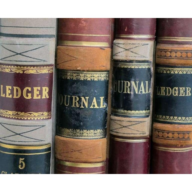 A Large and Unique Set of 4 Leather-Bound Accounting Ledgers with Gilt Highlights For Sale - Image 4 of 6