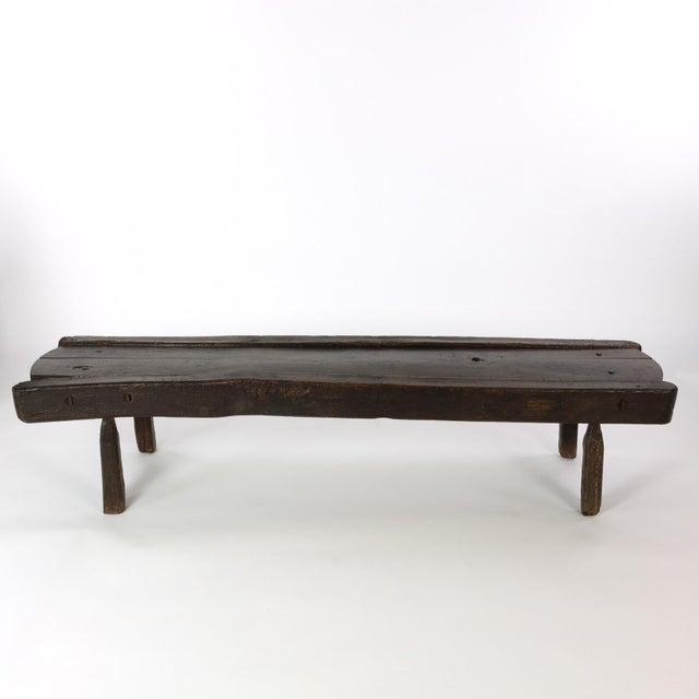 A low rustic oak bench likely the lower element of a cheese draining table from a dairy, lovely patina; English, circa...
