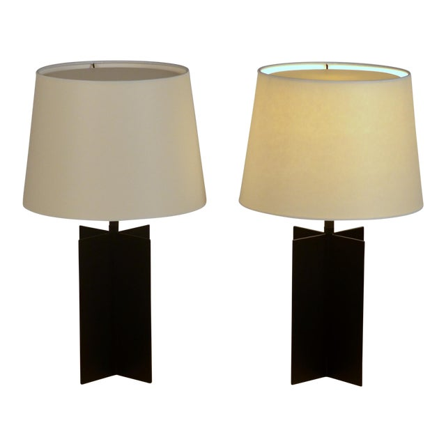 Pair of medium 'Croisillon' matte black steel table lamps by Design Frères. Matte black patinated wrought iron bases and...
