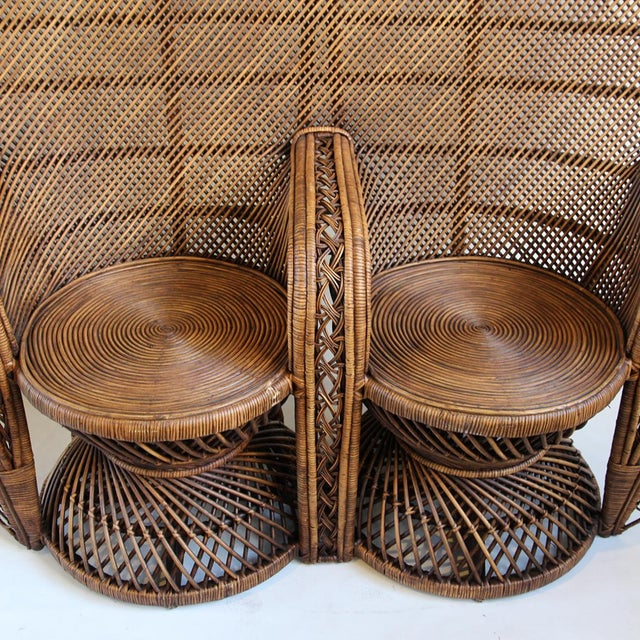 Double plantation style rattan peacock chair with a beautiful dark stained finish. This unique chair works indoors or...