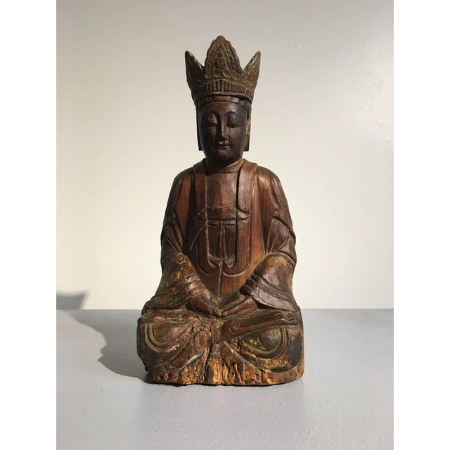 An attractive figure of a bodhisattva in meditation. He sits calmly in dhyanasana, slightly bent forward, hands in dhyana...