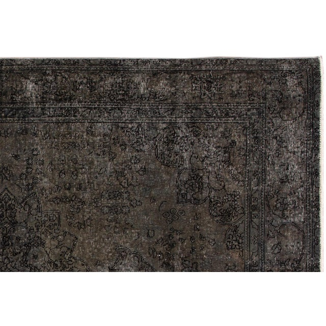 A hand-knotted Persian overdyed distressed rug with a medallion floral design. This piece has great detailing and colors....