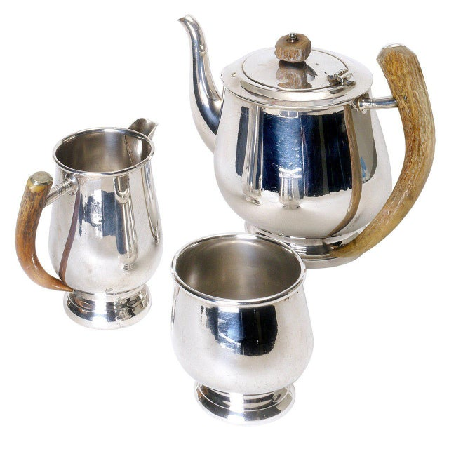 Silver plate tea pot with horn handle, sugar bowl and creamer with horn handle. Dimensions (cms) Coffee/ teapot H 14 x D...