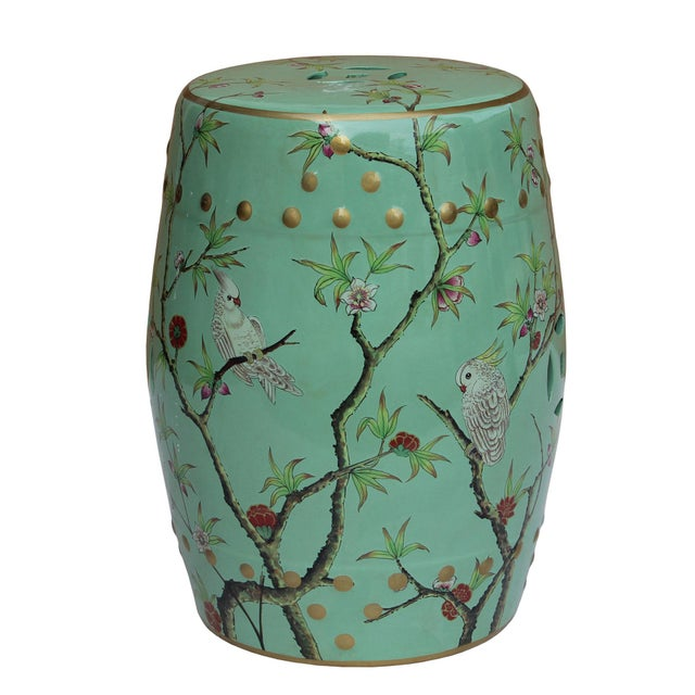 This is a hand painted colorful porcelain stool in a pastel blue green base color with mixed color flower and birds...