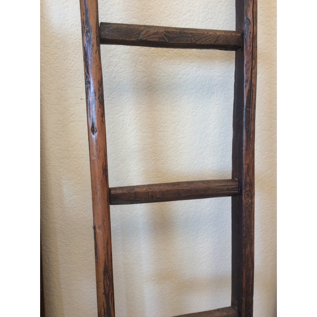 This ladder has a beautiful antique patina and warm worn finish. It is great for displaying or hanging. Because of its age...