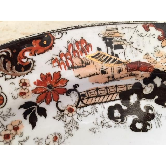 This is a oval platter in the Chinese Japan Pattern. It is in black, rust, and peach with a lot of gold accents. It...
